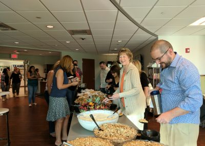Employees enjoying a special breakfast celebrating our Top Workplaces win